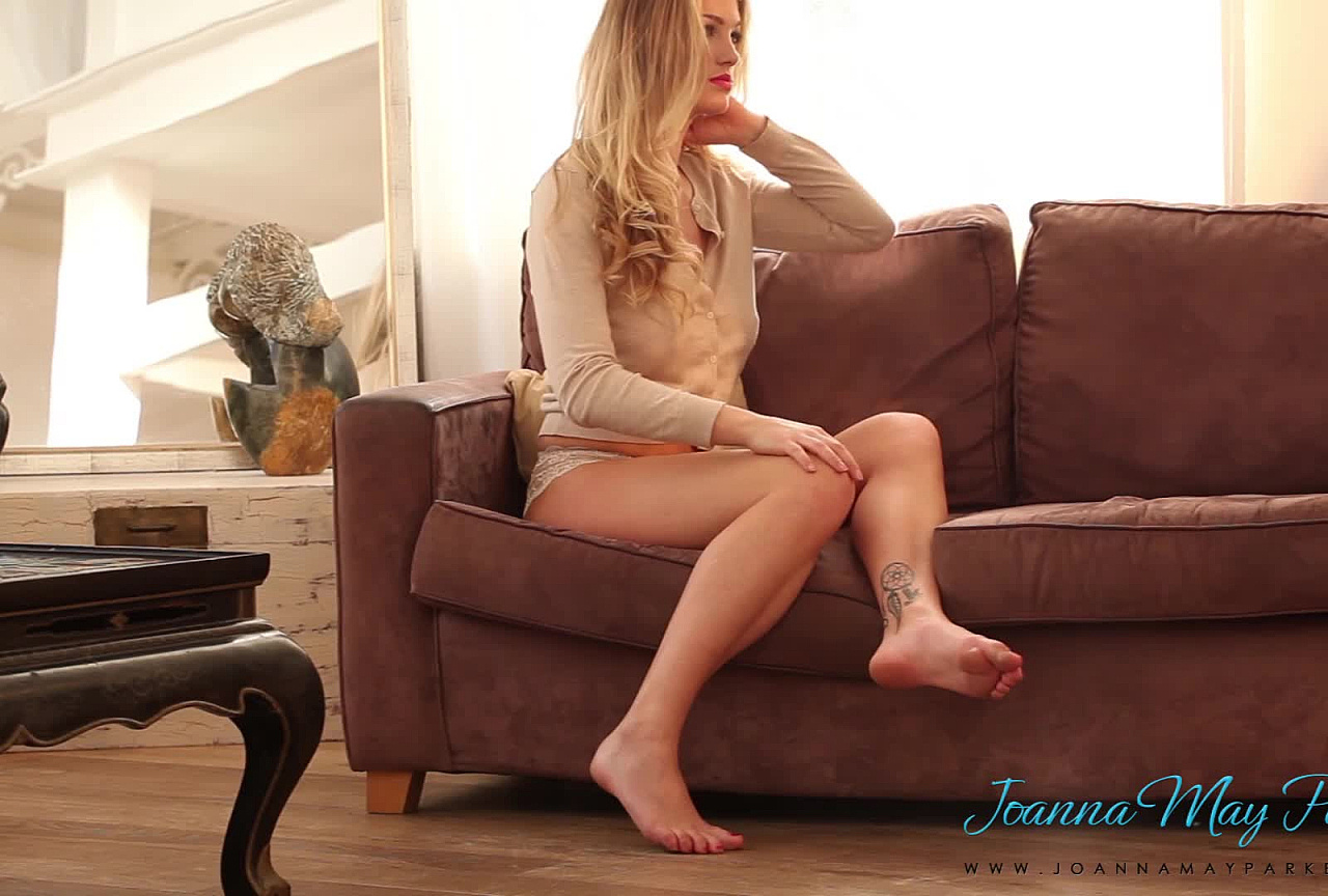 Joanna teasing on the couch BTS