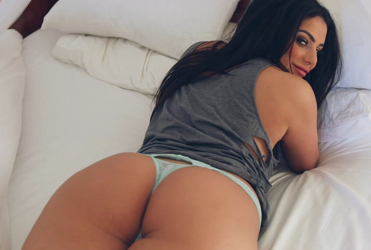 Charley Stripping on the Bed