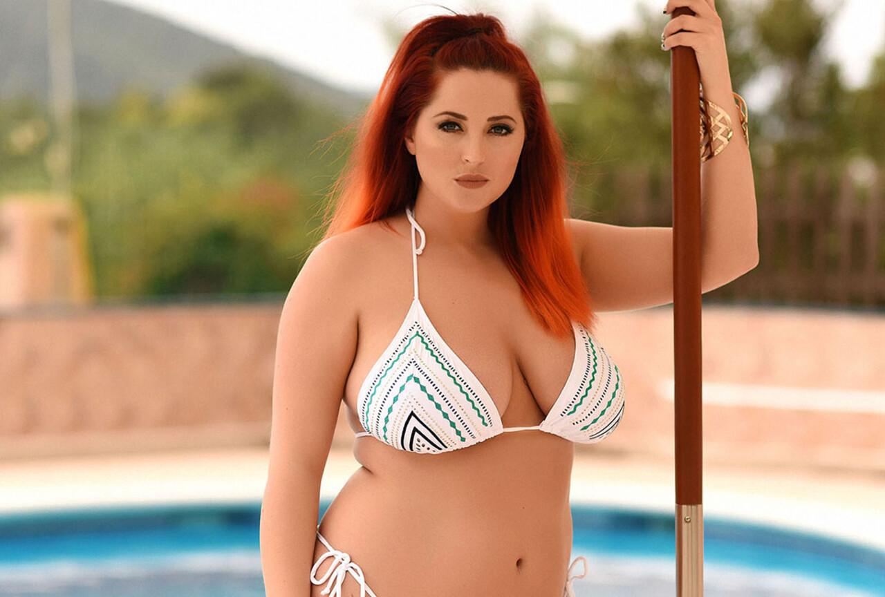 Lucy V Takes off Her Bikini Top