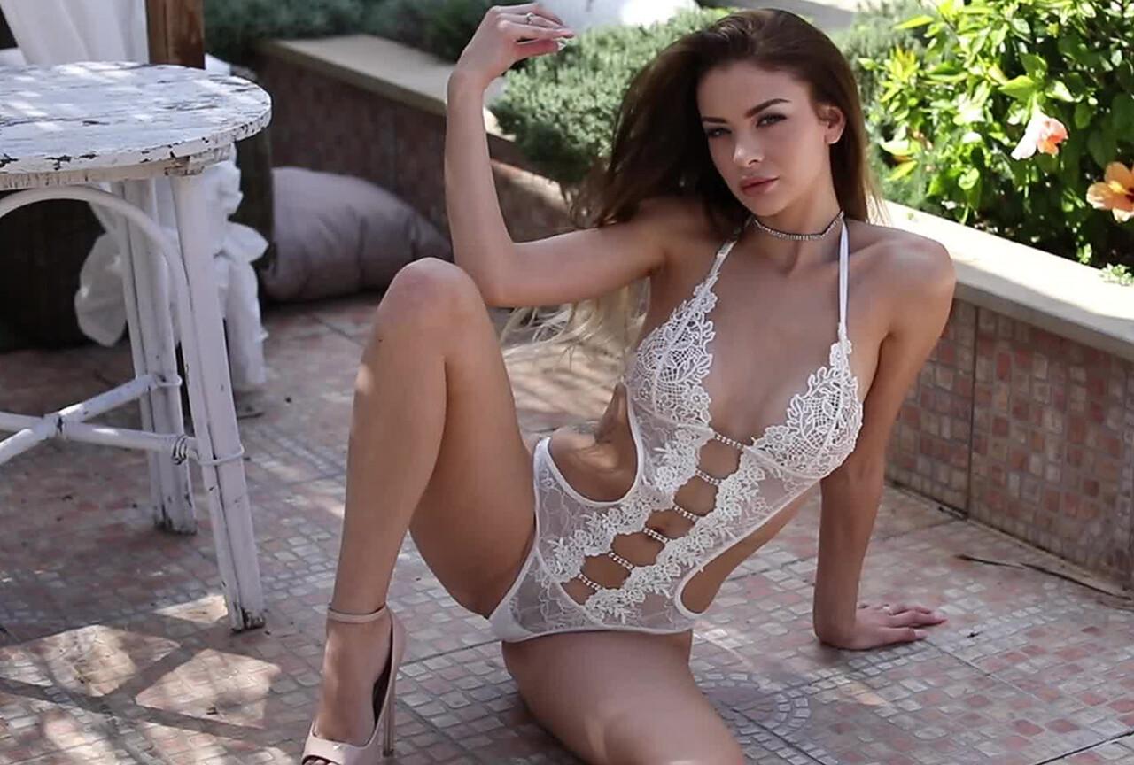 Emelia Paige Teasing in Her Sexy White Bodysuit