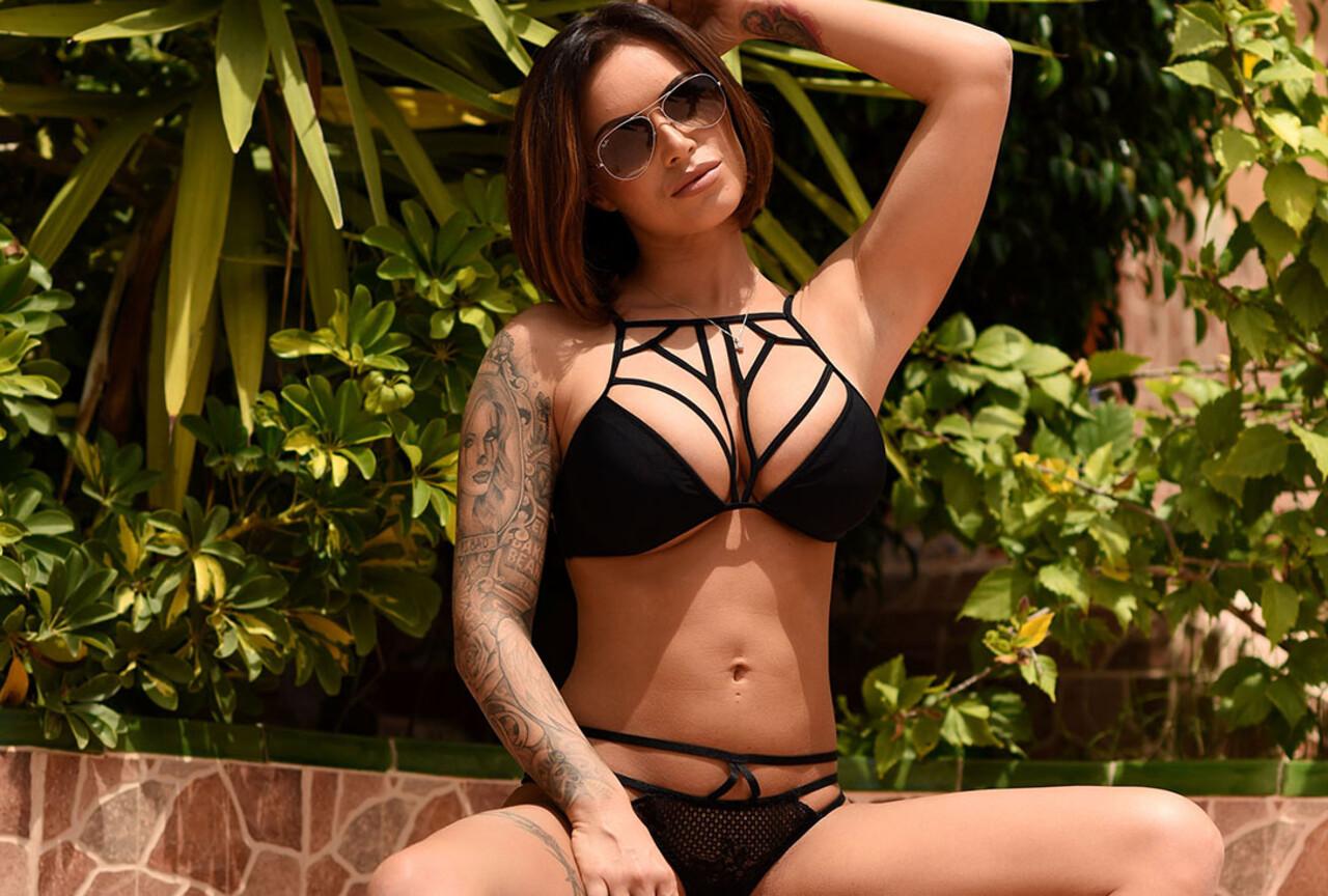 Gemma poses in a provocative black bikini
