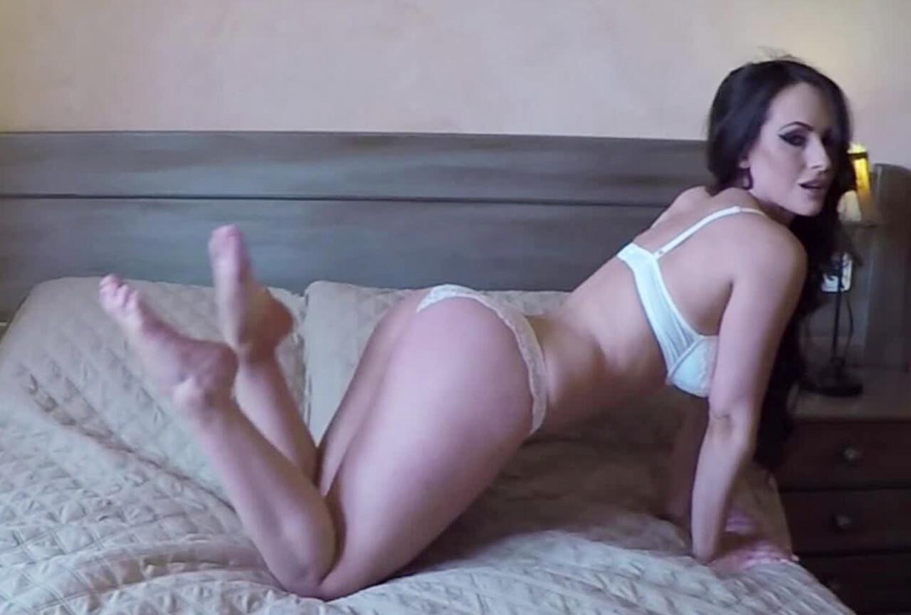 Anastasia Harris Doing a Striptease on the Bed