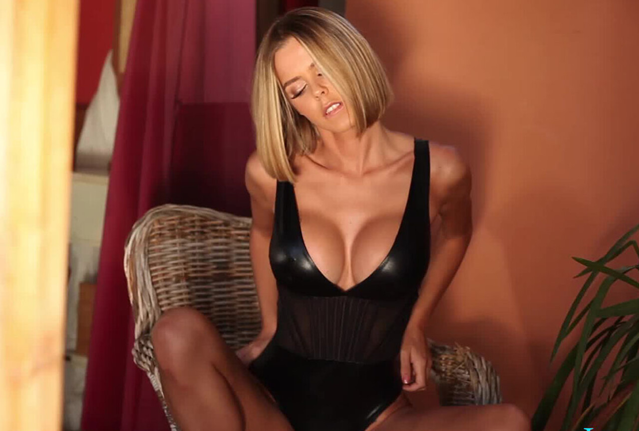 Jennifer Teasing in Black PVC bodysuit