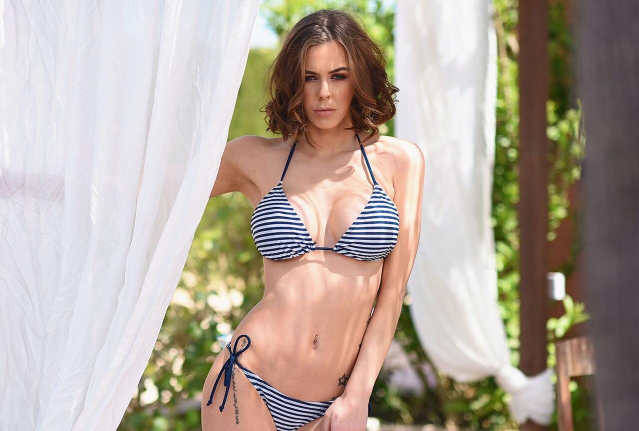 Jennifer strips nude from her bikini