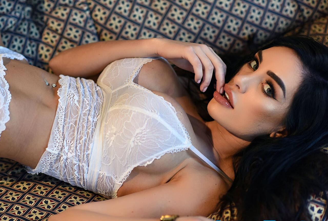 Ann Denise strips from white lingerie
